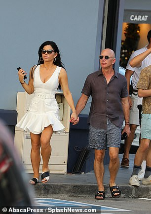 The couple held hands until they arrived at a local restaurant on the island on Monday