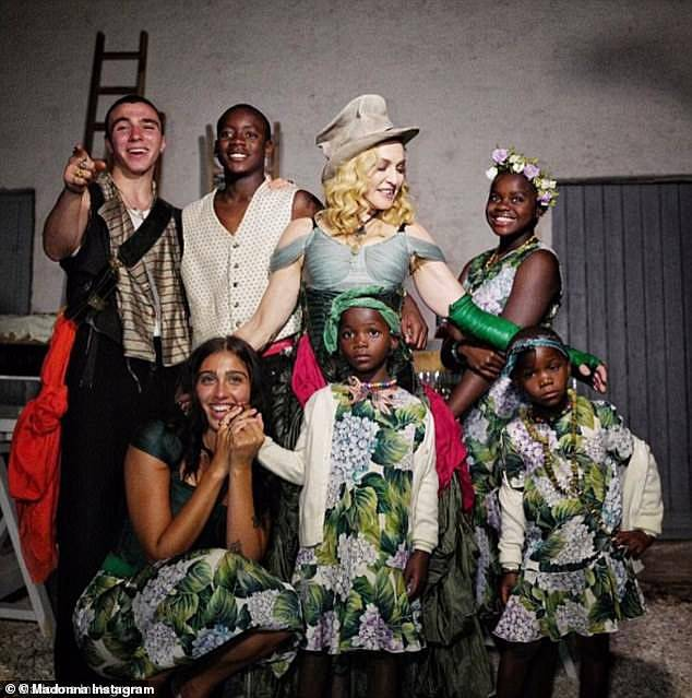 Children: Madonna posted this image of herself with her children in 2017. From left, Rocco, David Banda, Mercy James and front, Lourdes and twins Stelle and Estere