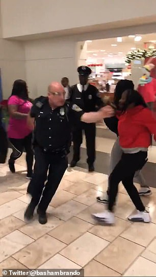 Amateur video shows a fight break out in front of a Macy's department store at a mall in Indianapolis on Sunday