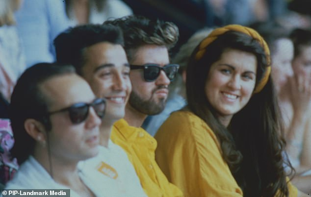 George Michael with Andrew Ridgeley and sister Melanie Panayiotou watching Live Aid at Wembley Stadium on July 13, 1985
