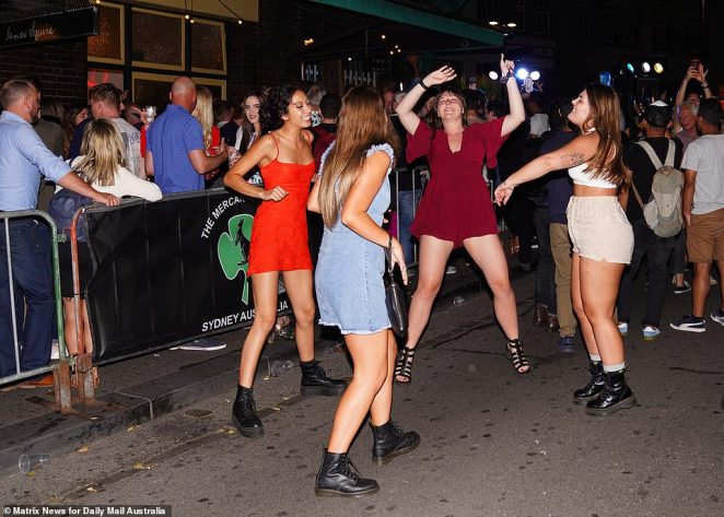 Who needs a club? This group of young woman opted to dance in the street - rather than join the long queue to enter a bar