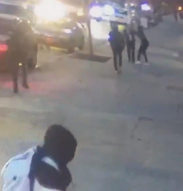 Startled, the man attempts to walk away from the group at speed but is then chased by two of the teenagers, who run towards him and then take it in turns to punch him