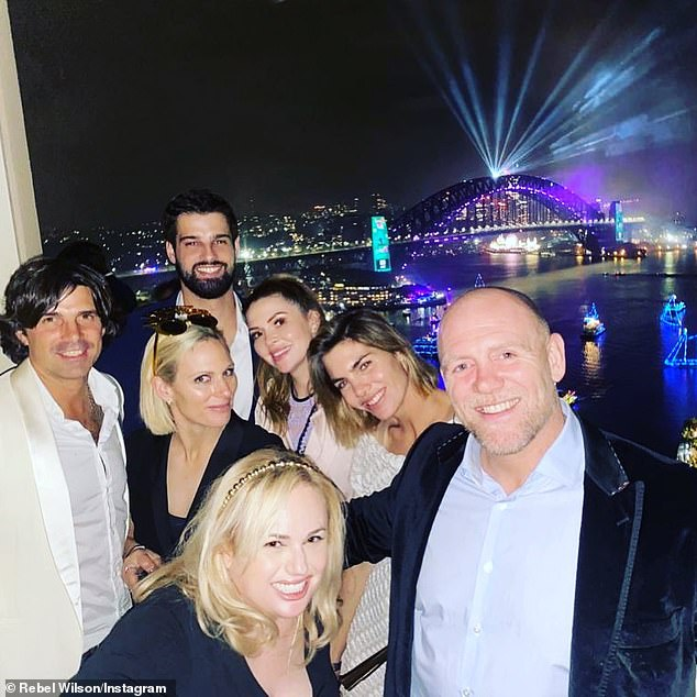 Celebrating in style: Zara (second left) and Mike (right) saw the New Year in spectacular style in Sydney, watching the fireworks with friends including actress Rebel Wilson (front) from a mansion overlooking the Sydney Harbour Bridge
