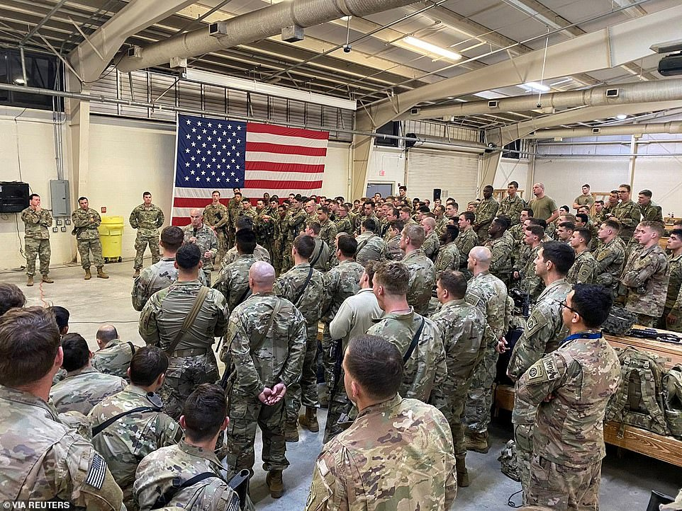 The first contingent of a paratroop infantry battalion from the U.S. Army's 82nd Airborne Division bound for Kuwait receive a briefing as they prepare to leave Fort Bragg, North Carolina on Wednesday