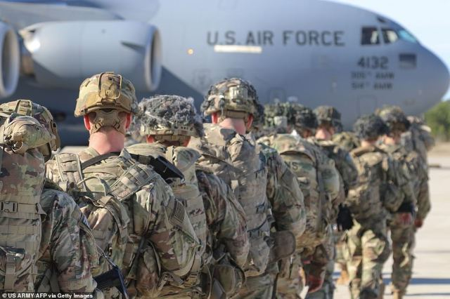 U.S. Army Paratroopers assigned to the 2nd Battalion, 504th Parachute Infantry Regiment, 1st Brigade Combat Team, 82nd Airborne Division, deploy from Pope Army Airfield, North Carolina on January 1, 2020