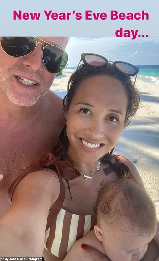 Proud parents: Myleene shared a loved-up snap with her boyfriend Simon and Apollo, in the Maldives on Tuesday