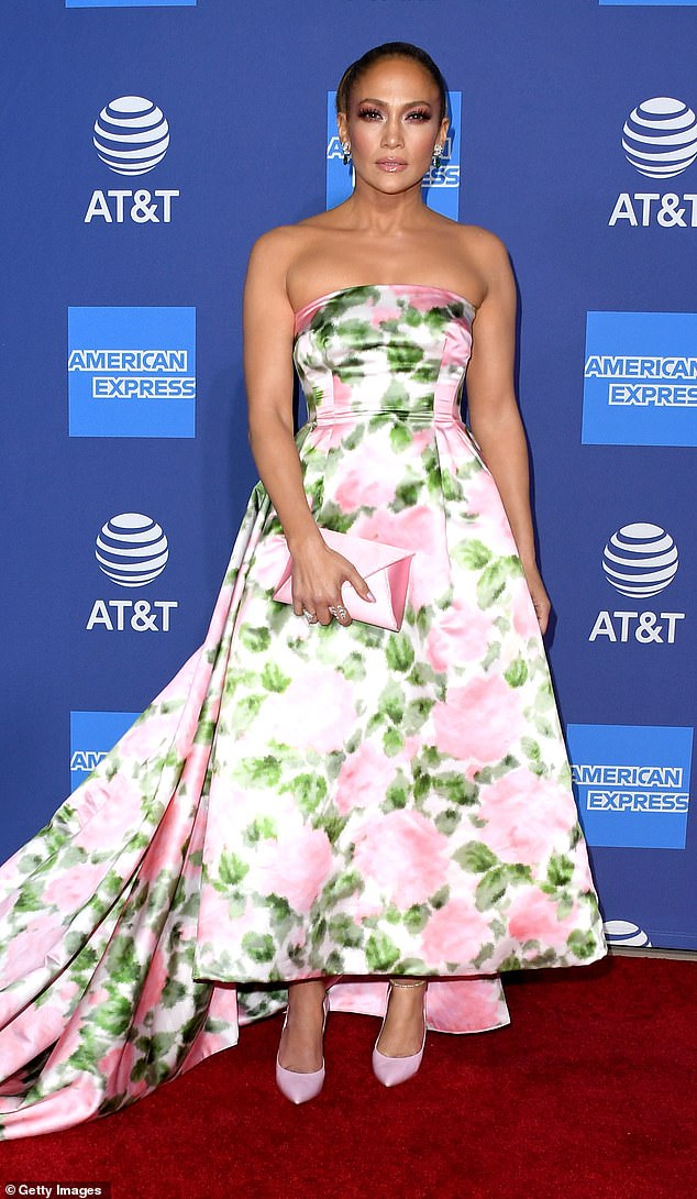 Floral theme: Lopez 's dress featured large pink roses and vibrant green leaves