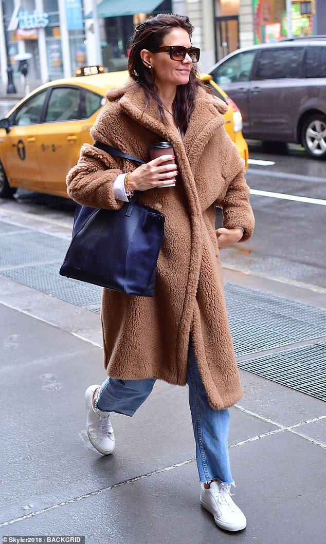 Casual cutie: The 41-year-old showcased her effortless street style as she donned her favorite Max Mara coat