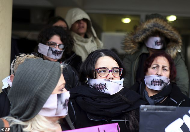 Protesters stage a demonstration outside a court house in Paralimni, Cyprus in December