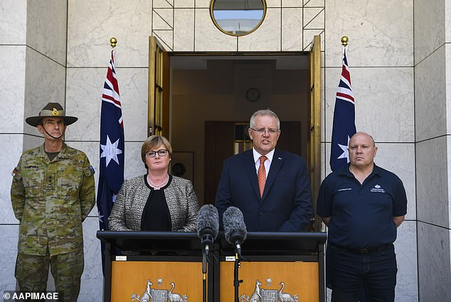 From left: Australian Defence Force chief Angus Campbell, Defence Minister Linda Reynolds, Prime Minister Scott Morrison and Director General of Emergency Management Australia Rob Cameron make the announcement from Parliament House, Canberra, on Saturday