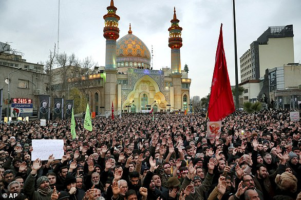 Protesters demonstrate over the U.S. airstrike in Iraq that killed Iranian Revolutionary Guard Gen. Qassem Soleimani in Tehran, Iran, Saturday. Red flags in Shia tradition symbolize both blood spilled unjustly and serve as a call to avenge a person who is slain