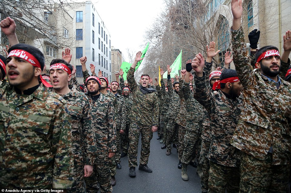 Iranian members of the Basij militia take part in an anti-US rally at Palestine Square in the capital Tehran on Saturday to protest the killing of Iranian Revolutionary Guards' Quds Force commander Qassem Soleimani by a US airstrike