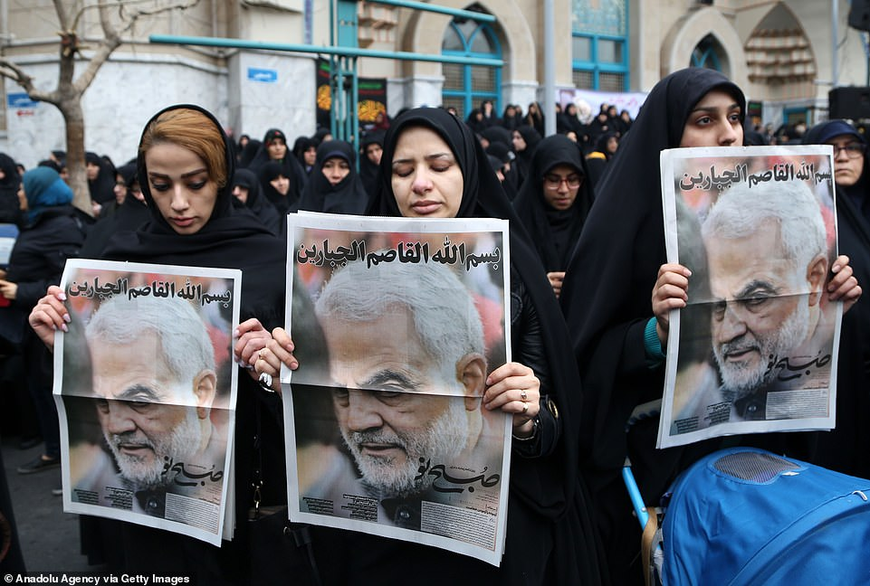 Women hold up posters of Soleimani as they protested his killing in the Iran capital on Saturday