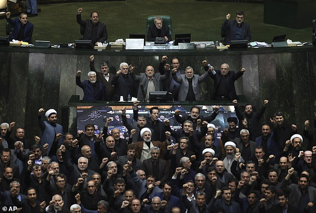 Iranian lawmakers chant anti-American and anti-Israeli slogans to protest against the US killing of Iranian top general Qassem Soleimani at the start of an open session of parliament in Tehran, Iran, on Sunday