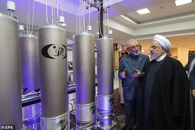 Iranian President Hassan Rouhani (right) and the head of Iran nuclear technology organisation Ali Akbar Salehi inspecting nuclear technology in Tehran last April