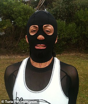 Ms Pitt in her mask and compression suit after she suffered burns to 65 per cent of her bodyafter she was caught in a raging fire during a marathonin 2011