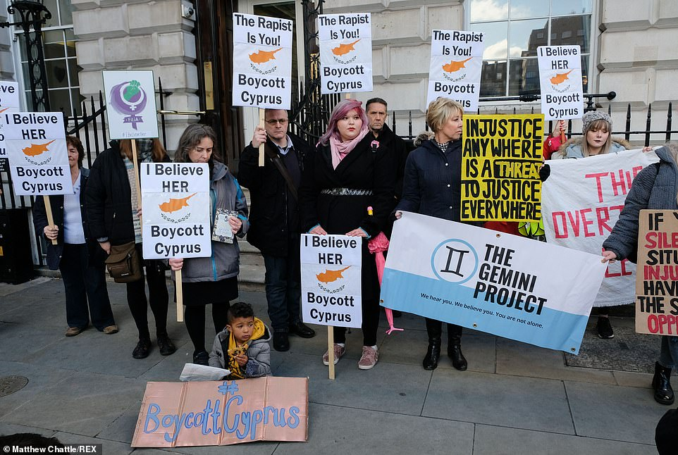 Protesters gather outside the Cypriot High Commission in London yesterday for the 19 year old girl accused of making a false gang rape claim in Cyprus by 12 Israeli men