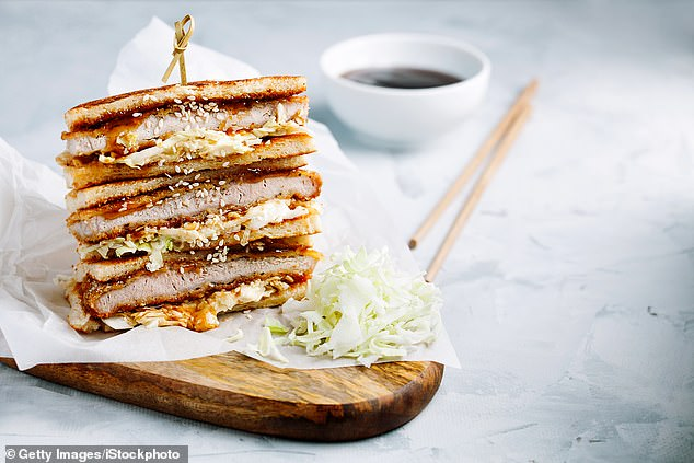 In 2009, London sandwich shop Tóu had runaway Insta-sucess with their £14 Iberico katsu sando; a Japanese-style sandwich of panko-crumbed pork neck fried in lardo, with cabbage and raspberry brown sauce. Pictured: Stock image of a Katsu Sando