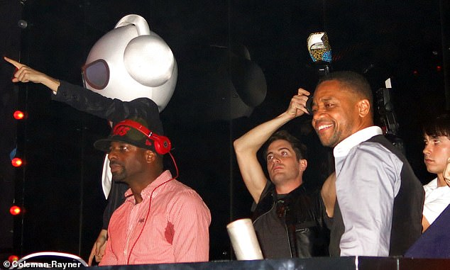 Gooding is seen with Dj Irie at the Marquee Nightclub in Manhattan behind the booth