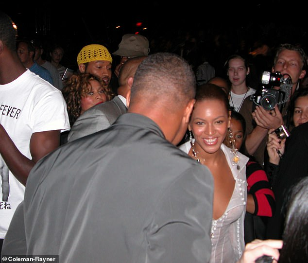 Gooding is seen facing Beyonce as they both attended the Rosa Cha By Amir Slama Fashion show in New York in 2003
