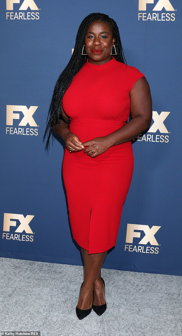 Vibrant: Uzo Aduba, 38, looked gorgeous in a scarlet red sleeveless dress with a split at the front and she added dark red lip color and angular silver earrings