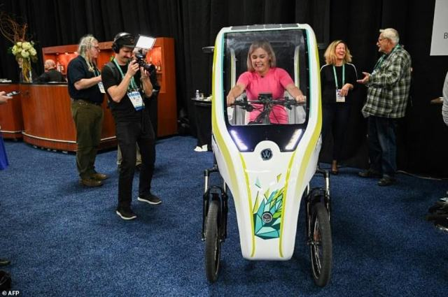 An attendee sits in the Wello solar electric tricycle during the CES Unveiled preview at the 2020 Consumer Electronics Show