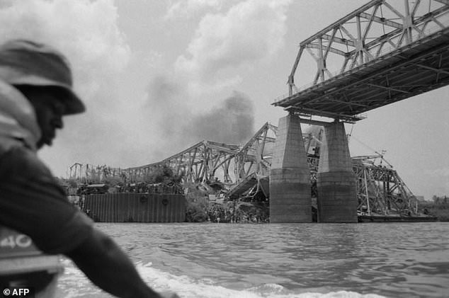 The Onitsha bridge,  one of the most important communication pathways of West Africa, is destroyed by the Biafran forces
