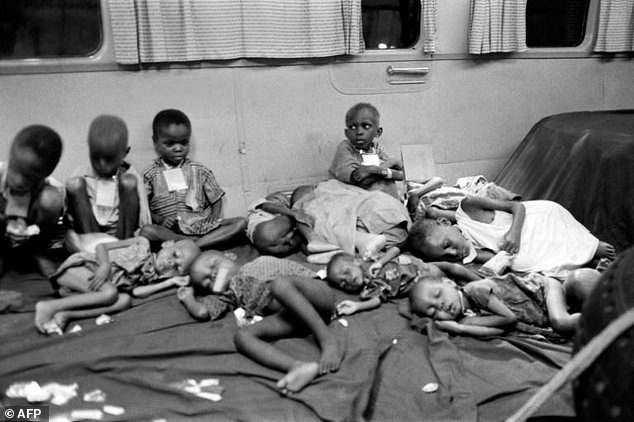 "Biafran children sit in a plane chartered by the International Red Cross (ICRC) and humanitarian organisation ""Terre des Hommes"""