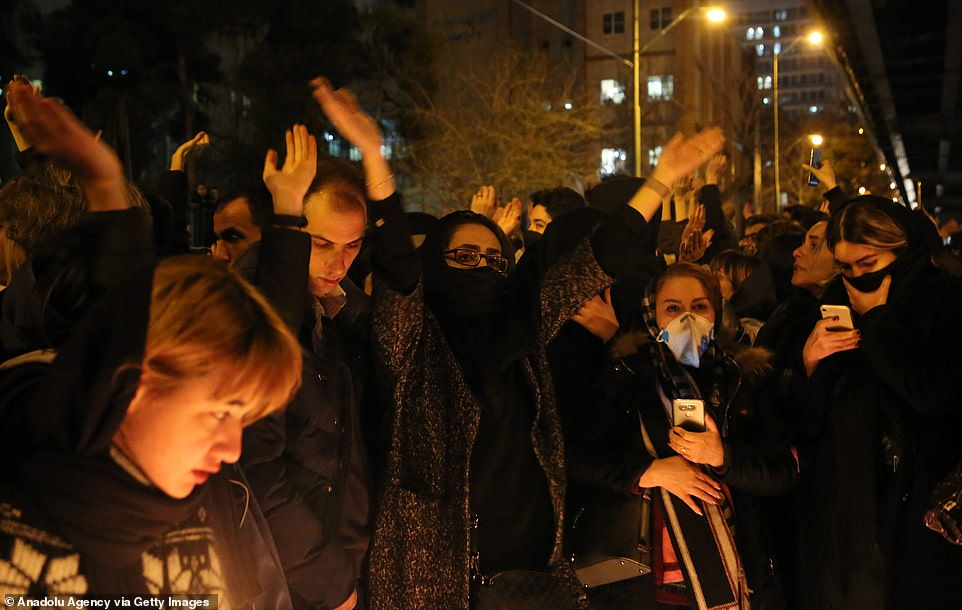 Iranians shout slogans against the government in protests in Tehran Saturday night