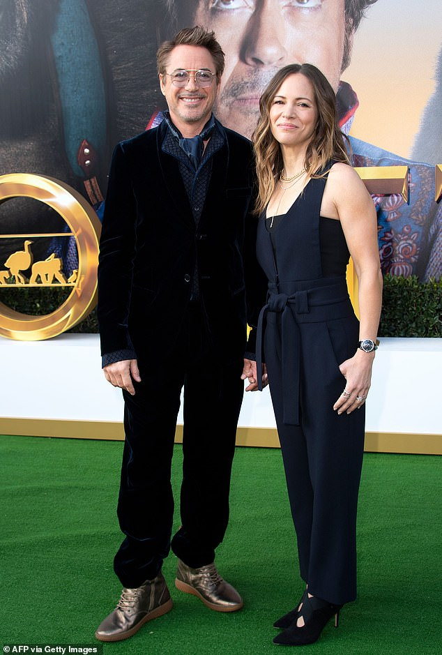 Loved up: The actor was joined by his long-term wife, Susan Downey, who acted as a producer on the movie