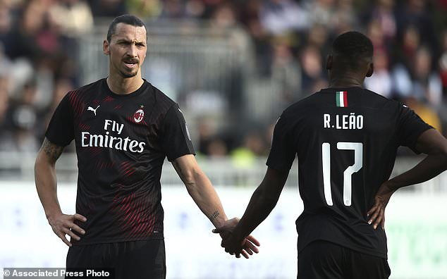 Milan's Zlatan Ibrahimovic congratulates Rafael Leao after the Portuguese scored is side's first goal during an Italian Serie A soccer match between Cagliari and Milan in Cagliari, Saturday, Jan. 11, 2020. (Spada(/LaPresse via AP)