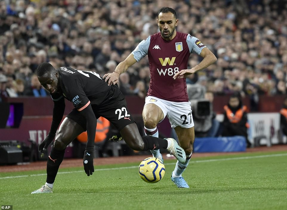 City left-back Benjamin Mendy duels for the ball with Aston Villa's Ahmed Elmohamady during the Premier League game