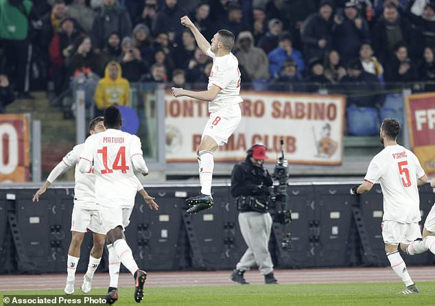 Juventus' Merih Demiral, centre, celebrates after scoring his side's opening goal during the Serie A soccer match between Roma and Juventus at the Rome Olympic Stadium, Italy, Sunday, Jan. 12, 2020. (AP Photo/Andrew Medichini)