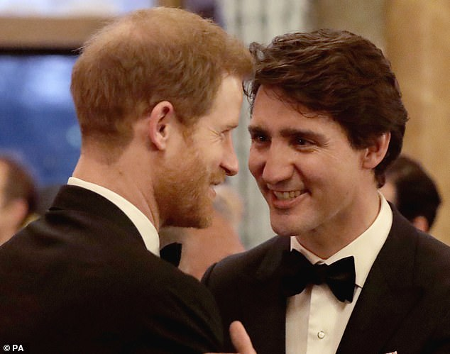 Prince Harry greets Justin Trudeau in the Blue Drawing Room at Buckingham Palace in London during the Commonwealth Heads of Government Meeting in April 2018. Mr Trudeau had previously promised that the couple would be safe when in Canada