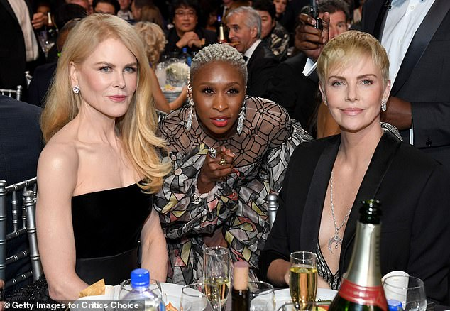 Centre stage: Cynthia Erivo is pictured with Nicole Kidman and Charlize Theron this year.Should she win an Oscar she would become the youngest of the rare 'EGOT' club – having Emmy, Grammy, Oscar and Tony awards