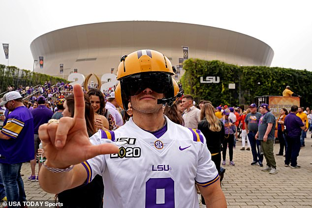 An LSU fan poses for a picture before the College Football Playoff national championship game