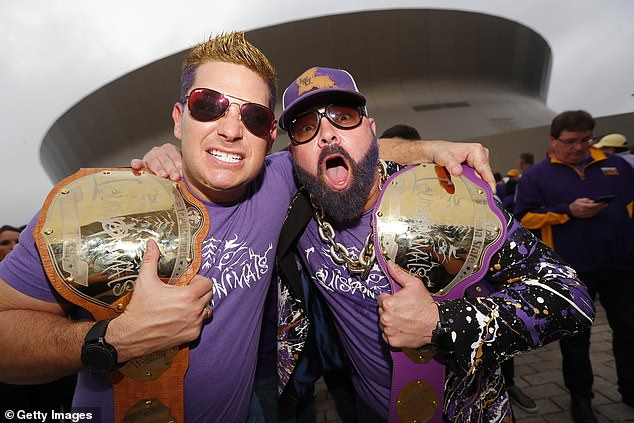 LSU Tigers fans pose with homemade wrestling belts ahead of Monday's national title game