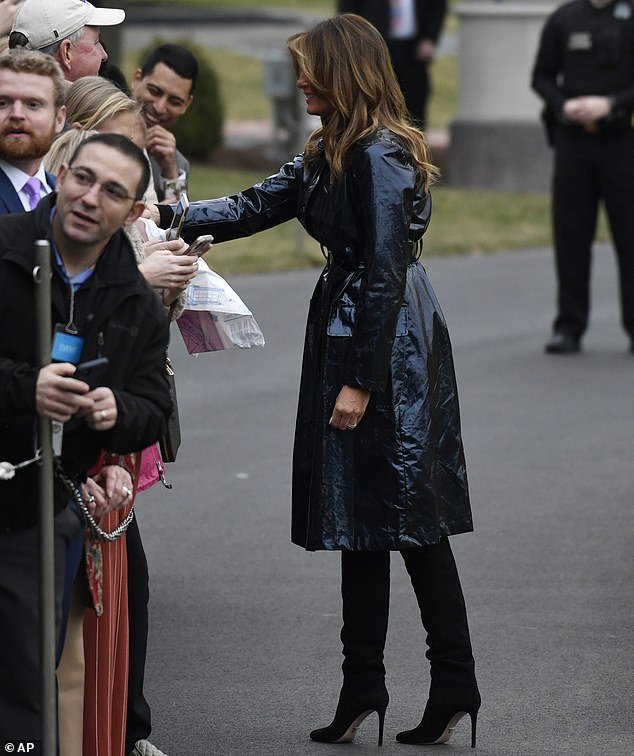 Saying hi: Melania stopped to greet fans while walking across the South Lawn of the White House with her husband