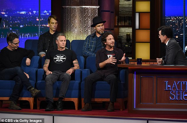 Artistic payoff: 'It was emotionally dark and confusing at times, but also an exciting and experimental road map to musical redemption,' guitarist Mike McCready (center-front) said in a statement of the the 'long journey' making the new album