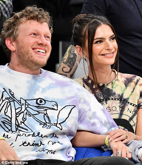 Her look: The brunette beauty wore a tie-dye crop top and light denim jeans