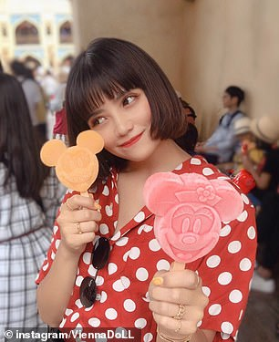 Pictured: Vienna poses with Mickey and Minnie Mouse themed ice lollies inside a Disney park