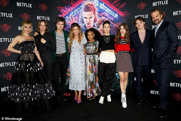 All together: Netflix's Stranger Things is now in its third series, which was released in July 2019, and is set to return for a fourth season (pictured L-R is Cara Buono, Maya Hawke, Joe Keery, Millie Bobby Brown, Priah Ferguson, Carmen Cuba, Natalia, Charlie and David Harbour)