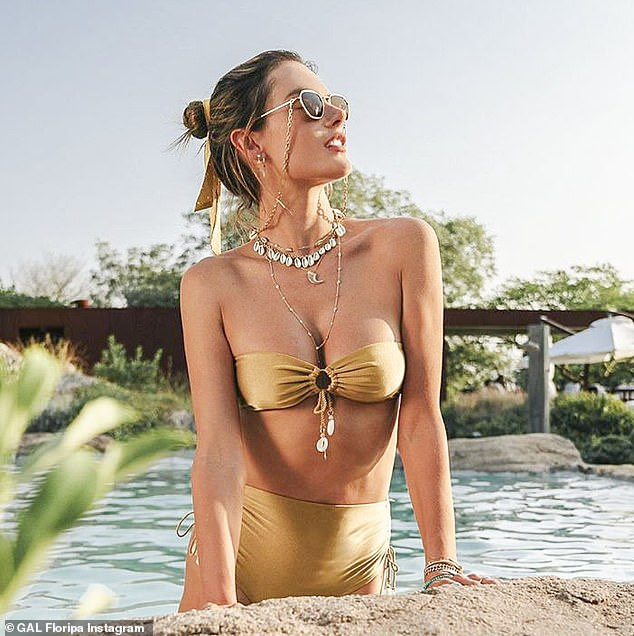 Golden girl: Alessandra Ambrosio has joked that her life is one long vacation and she does not seem to be joking. On Tuesday the 38-year-old Vogue model shared a photo from Uruguay where she wore a stunning gold bikini from her very own line GAL Floripa