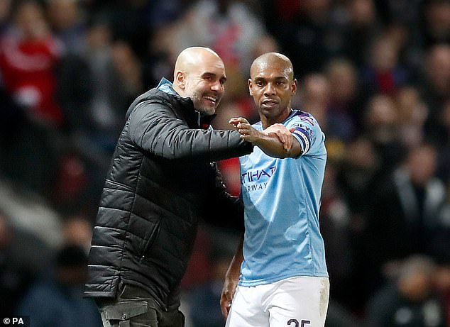 Pep Guardiola (left) was forced to play midfielder Fernandinho (right) in central defense