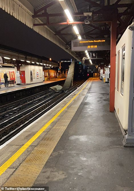 Part of the roof was blown onto the tracks at Ravenscourt Park Underground station in West London yesterday evening