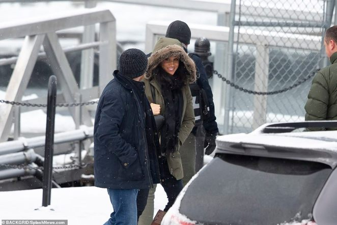 Meghan seemed relaxed and happy as she walked toward the plane that had other paying customers on board