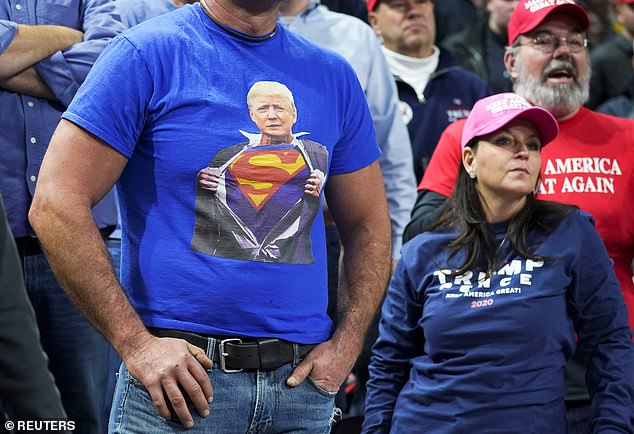 A man at the Milwaukee rally wore a shirt depicting the president emergingv from his business suit as Superman