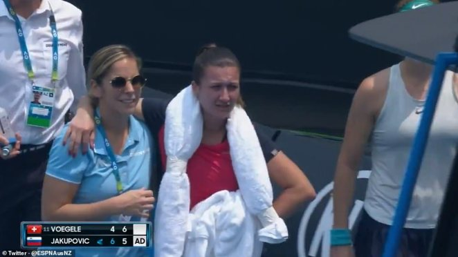 The Slovenian is helped from the court by medical staff and later said she felt 'scared' on court due to the poor conditions caused by the smoke