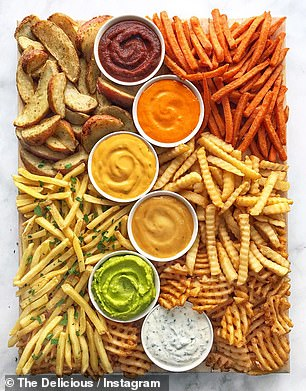 A growing number of Australians are shunning traditional cheese boards in favour of creating quirky grazing platters laden with an assortment of fries and dipping sauces