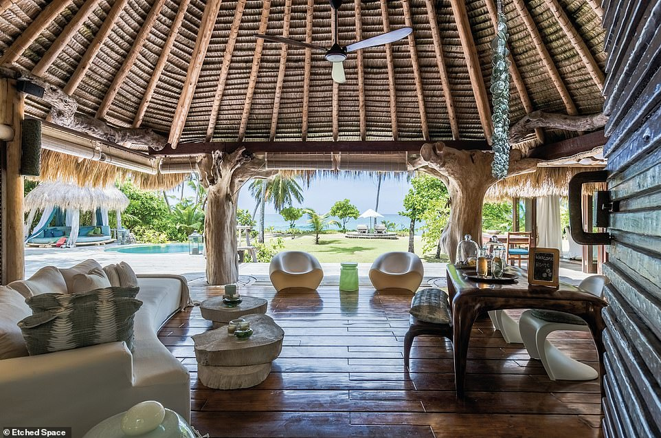 Villa North Island, pictured, is located on the 5,000-acre private island of North Island in Seychelles. The one-bedroom suite 'spillsonto East Beach, where you¿re unlikely to see another soul, except for the endemic wildlife'. Stays start from$11,200 (£8,600) per night